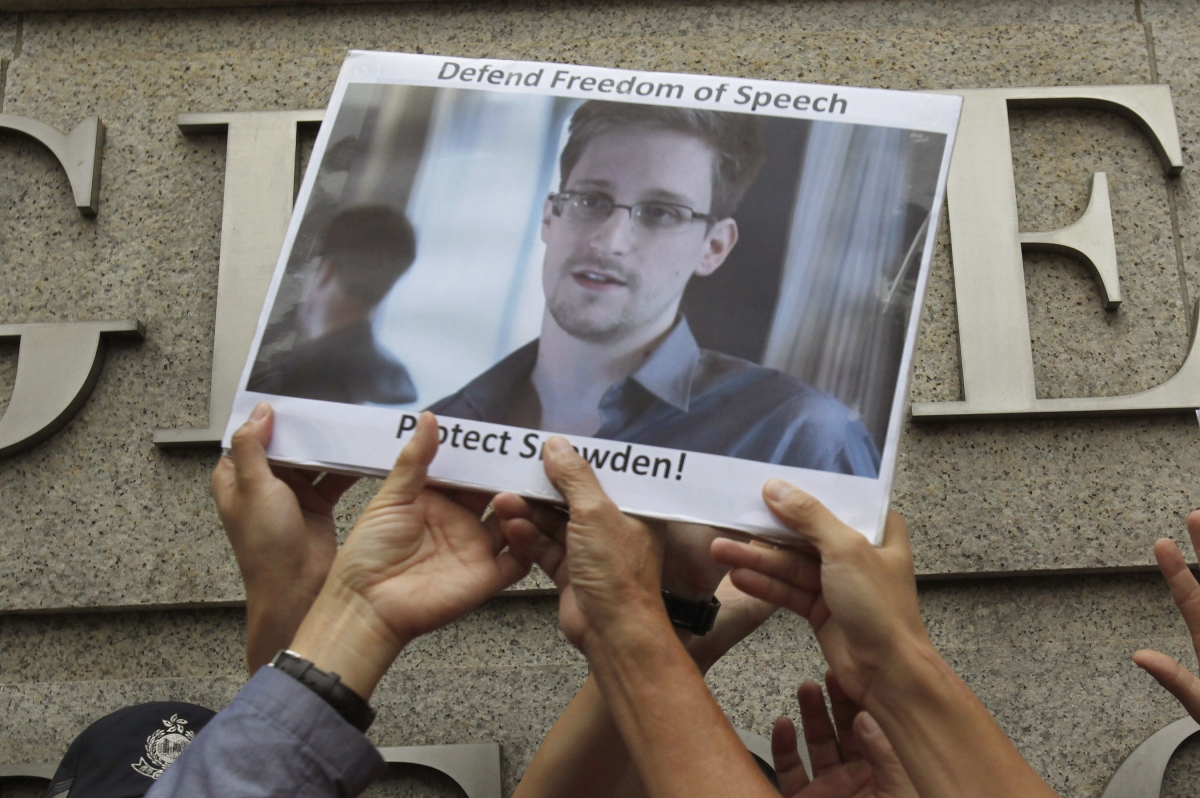 Edward Snowden sign held up by protesters