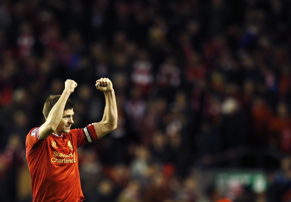 Liverpool's Steven Gerrard acknowledges fans after their English Premier League soccer match against Sunderland at Anfield in Liverpool, northern England March 26, 2014.