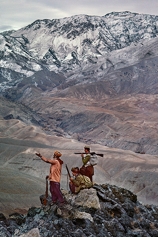 Mujahideen stand atop a mountain in the Hindu Kush, 1984