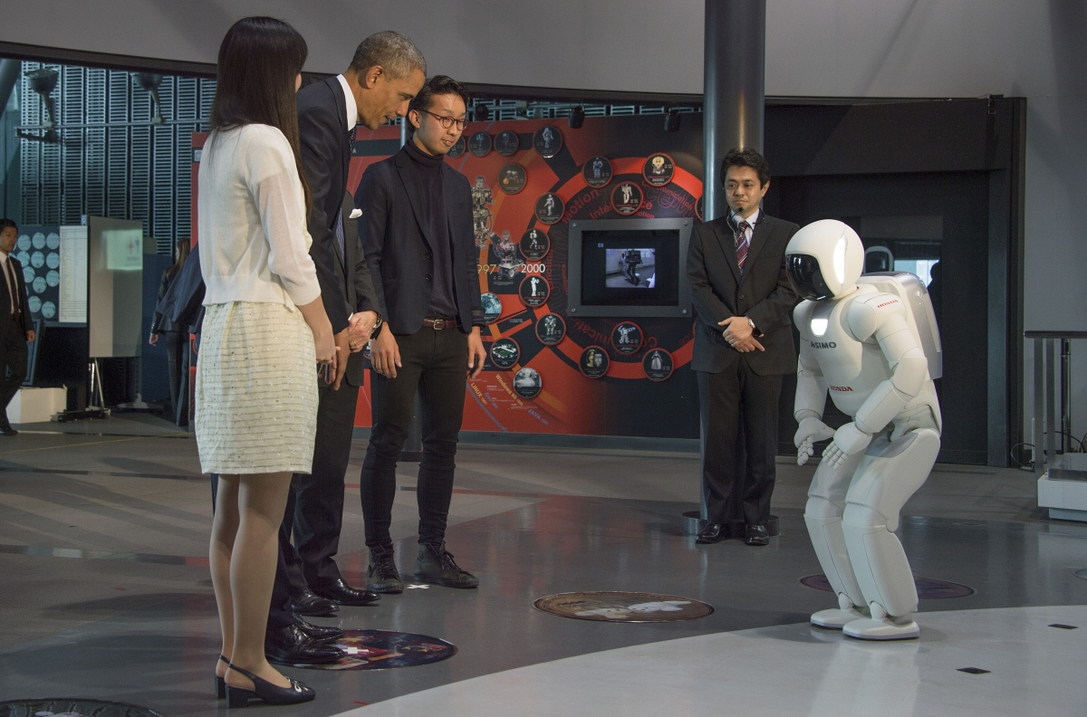 President Obama bows to Honda's humanoid robot ASIMO