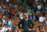 Bayern Munich\'s coach Josep Guardiola reacts during the Champions League semi-final first leg soccer match against Real Madrid at Santiago Bernabeu stadium in Madrid April 23, 2014.