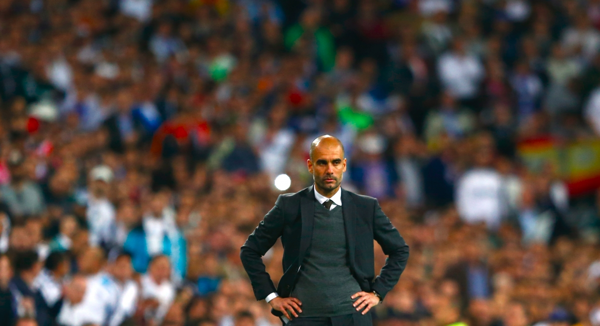 Bayern Munich's coach Josep Guardiola reacts during the Champions League semi-final first leg soccer match against Real Madrid at Santiago Bernabeu stadium in Madrid April 23, 2014.
