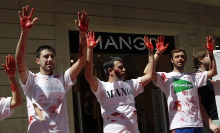 Activists from Spanish trade union UGT (General Union of Workers) hold up hands covered in fake blood as they take part in a protest in front of a Mango store in central Barcelona May 7, 2013.