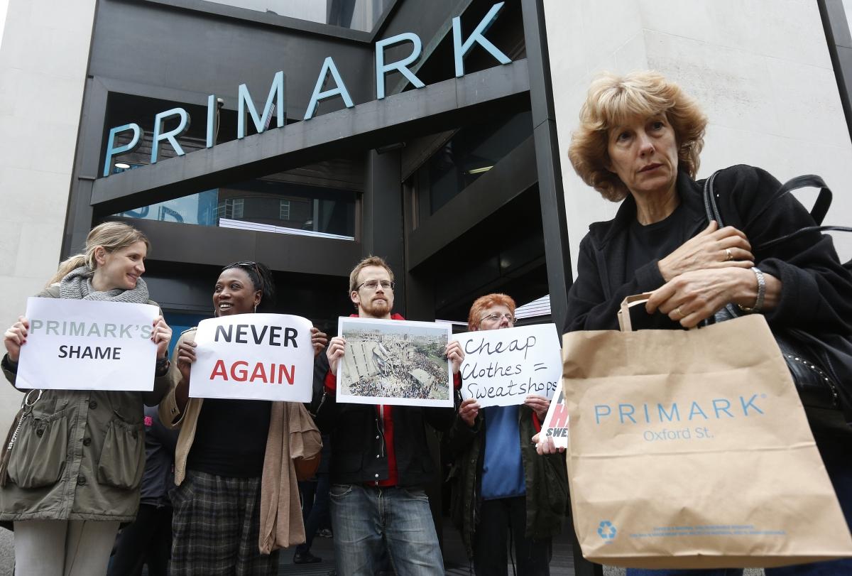Post Rana Plaza: A shopper passes demonstrators outside clothing retailer Primark in central London April 27, 2013.