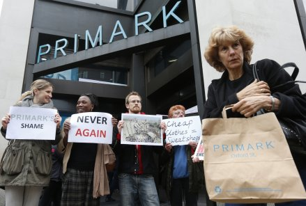 Post Rana Plaza: A shopper passes demonstrators outside clothing retailer Primark in central London April 27, 2013.