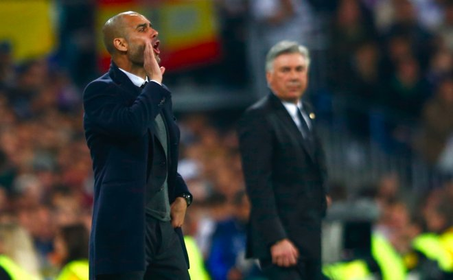 Bayern Munich's coach Josep Guardiola (L) reacts as Real Madrid's coach Carlo Ancelotti (R) looks on during their Champions League semi-final first leg soccer match at Santiago Bernabeu stadium in Madrid April 23, 2014.