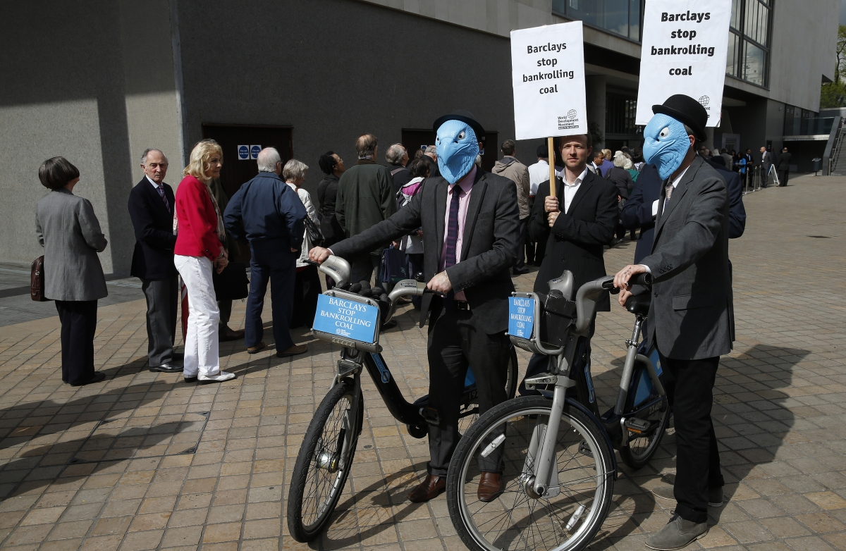 Demonstrators protest as shareholders queue to enter the Barclays AGM in central London April 24, 2014