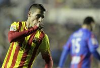 Barcelona\'s Cristian Tello celebrates after he scored against Levante during their Spanish King\'s Cup quarter-final first leg soccer match at the Ciudad de Valencia stadium in Valencia, January 22, 2014.
