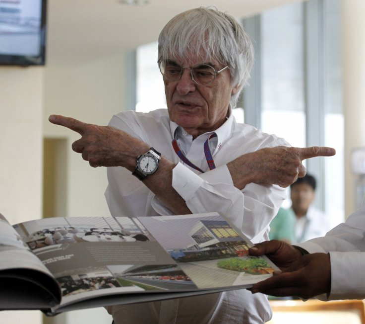 Formula One supremo Bernie Ecclestone gestures during the presentation of a commemorative book presented to him