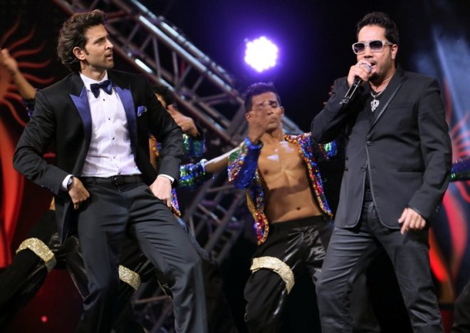 Hrithik Roshan and Bollywood singer Mika Singh performing at IIFA 2014