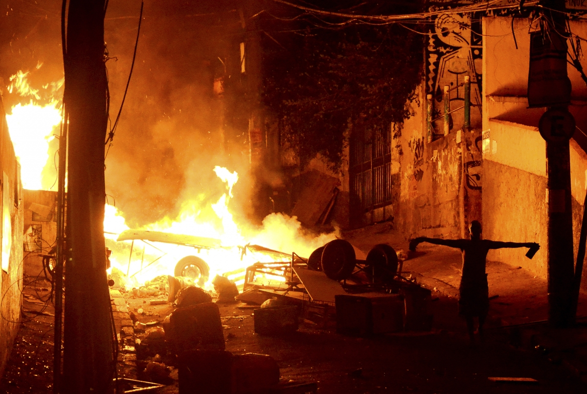 Violence flares in the Pavao Pavaozinho slum in Rio de Janeiro following the death of a local.