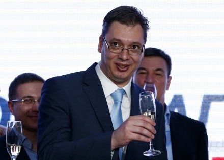 Serbian Deputy Prime Minister and the leader of Serbian Progressive Party (SNS) Aleksandar Vucic toasts with champagne at the party headquarters in Belgrade March 16, 2014.