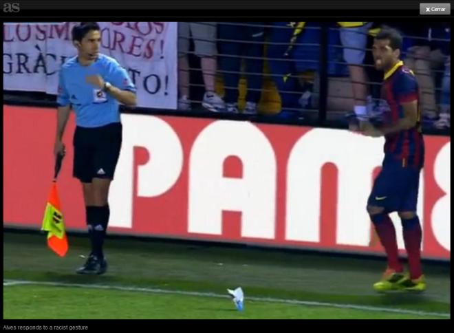 Alves eats banana thrown at him at the Madrigal