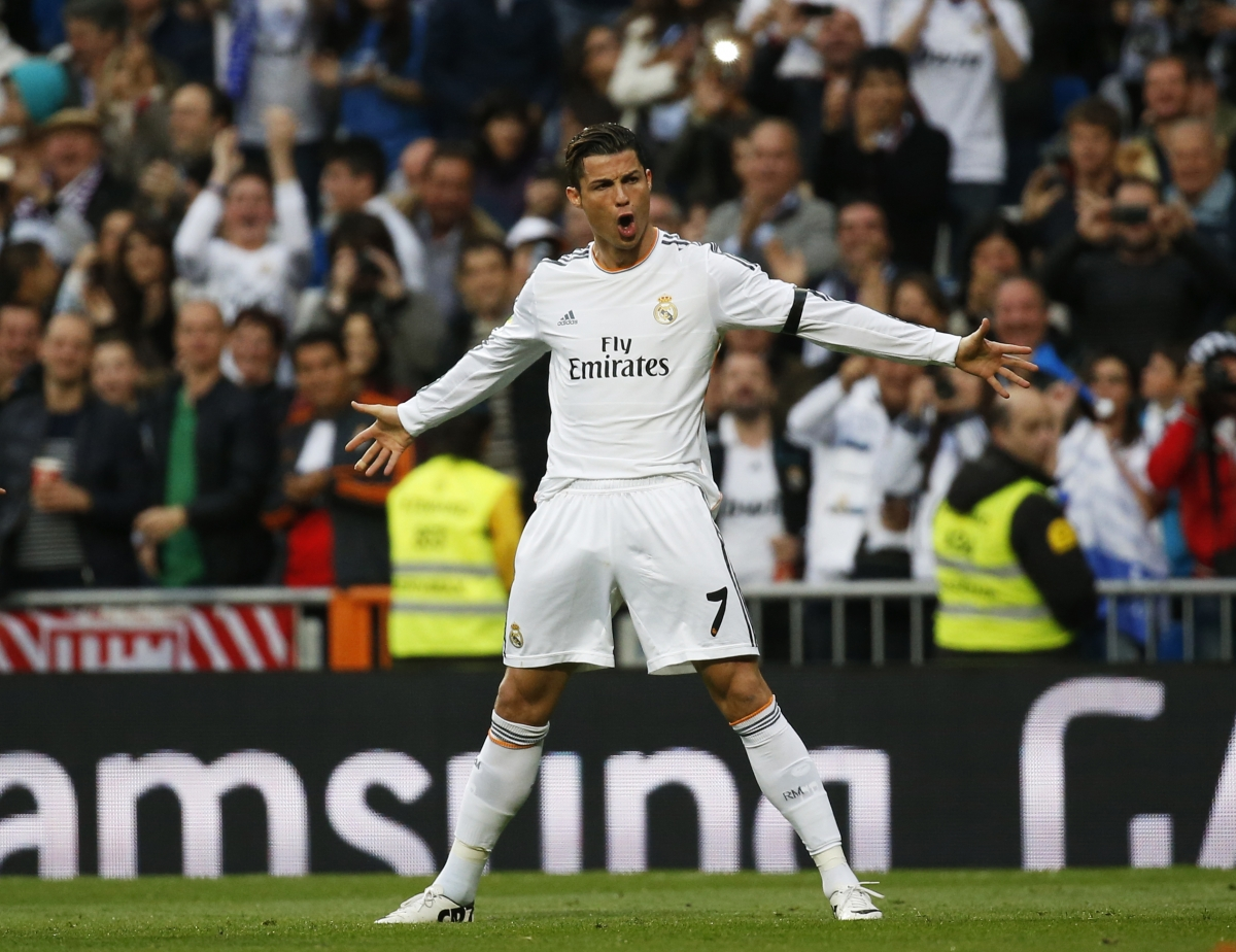 Real Madrid's Cristiano Ronaldo celebrates his goal against Osasuna during their Spanish First Division soccer match at Santiago Bernabeu stadium in Madrid April 26, 2014.