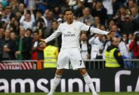 Real Madrid\'s Cristiano Ronaldo celebrates his goal against Osasuna during their Spanish First Division soccer match at Santiago Bernabeu stadium in Madrid April 26, 2014.