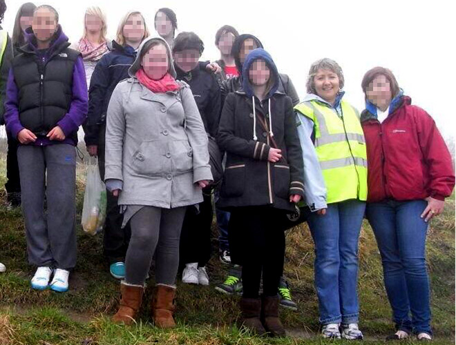 Anne Maguire (r) is pictured with pupils from Corpus Christi Catholic College on a school outing