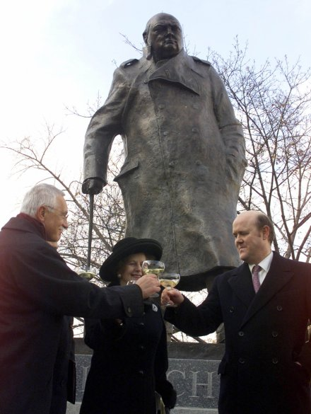 Former British Prime Minister Margaret Thatcher (C) and the grandson of Winston Churchill, Rupert Soames (R), at the unveiling ceremony of Sir Winston Churchill's statue in Prague, 1999