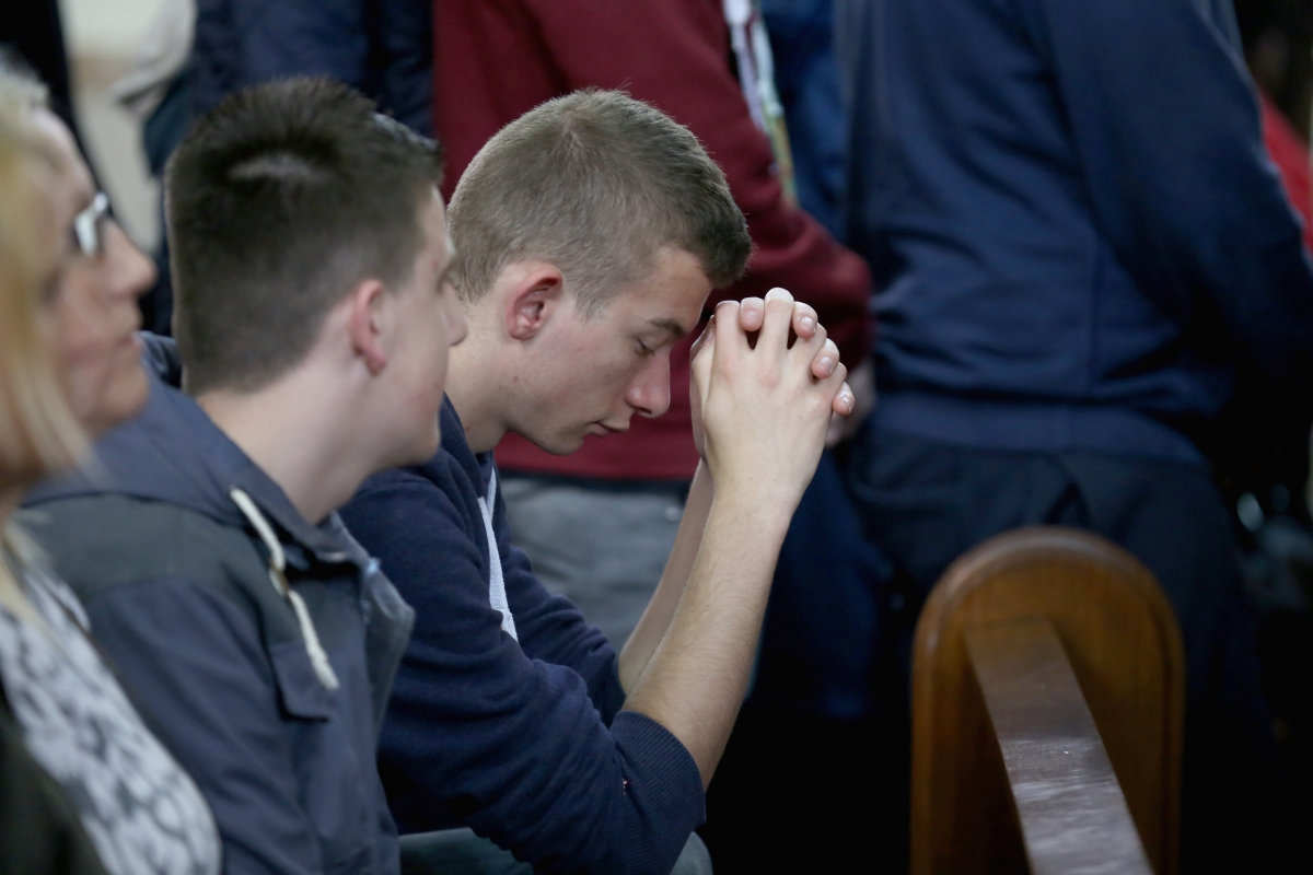 Students attend Corpus Christ Catholic Church in memory of Anne Maguire, who was stabbed to death in the school next door