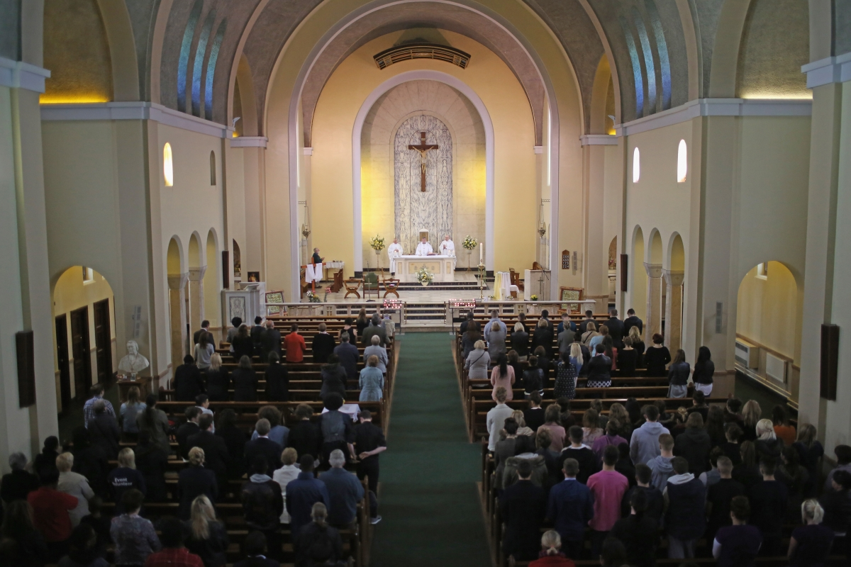 Monsignor Paul Fisher conducts mass at Corpus Christ Catholic after teacher Ann Maguire was stabbed to death in the school next door