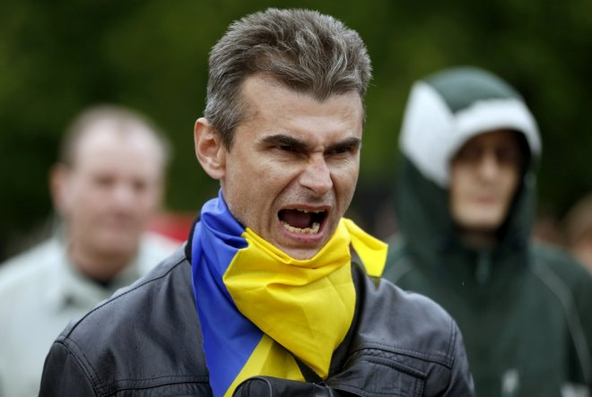 A pro-Ukranian activist shouts slogans during a rally in Luhansk, eastern Ukraine, April 28