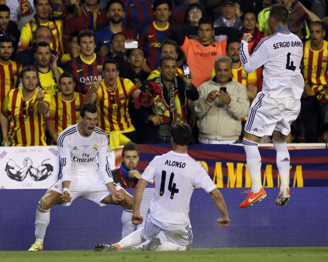 Real Madrid's Gareth Bale celebrates his goal with teammates Xabi Alonso (C) and Sergio Ramos (R) during their King's Cup final soccer match against Barcelona at Mestalla stadium in Valencia April 16, 2014.