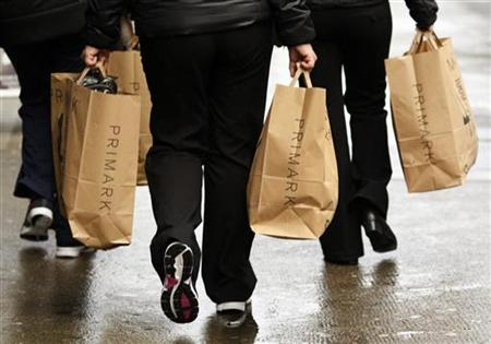 Shoppers carrying Primark bags