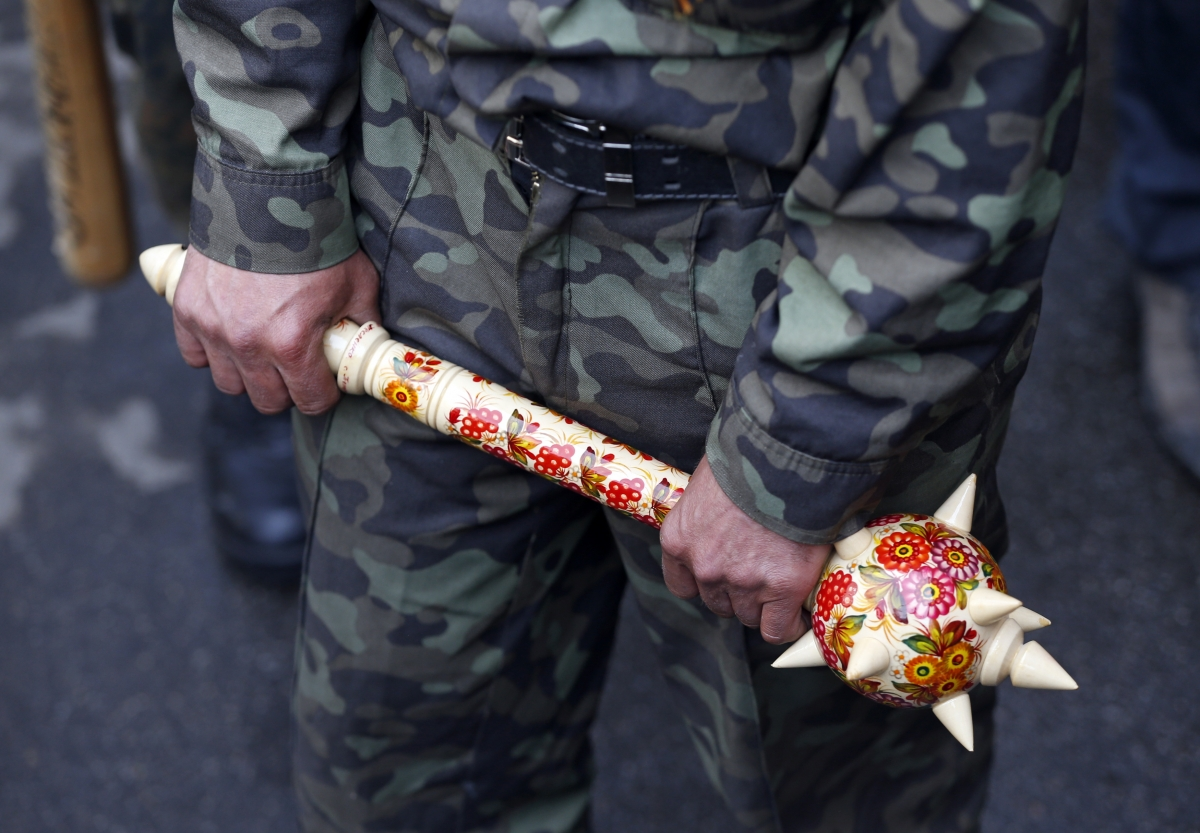 A pro-Russian activist holds a mace outside the regional government headquarters in Luhansk, eastern Ukraine