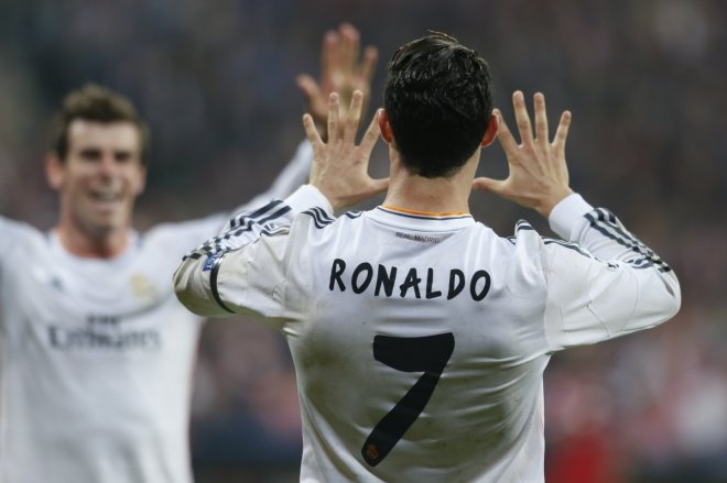 Real Madrid's Cristiano Ronaldo celebrates with Gareth Bale (L) after scoring a goal against Bayern Munich during their Champion's League semi-final second leg soccer match in Munich April 29, 2014.