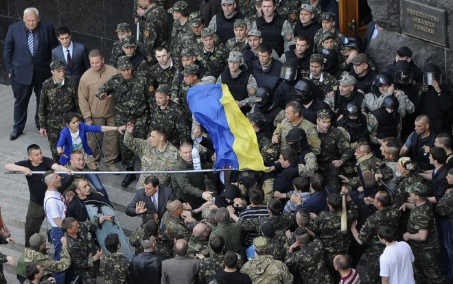 Members of Ukraine's State Security Administration (top) clash with members of the Euromaidan movement's self-defence units during a rally in Kiev