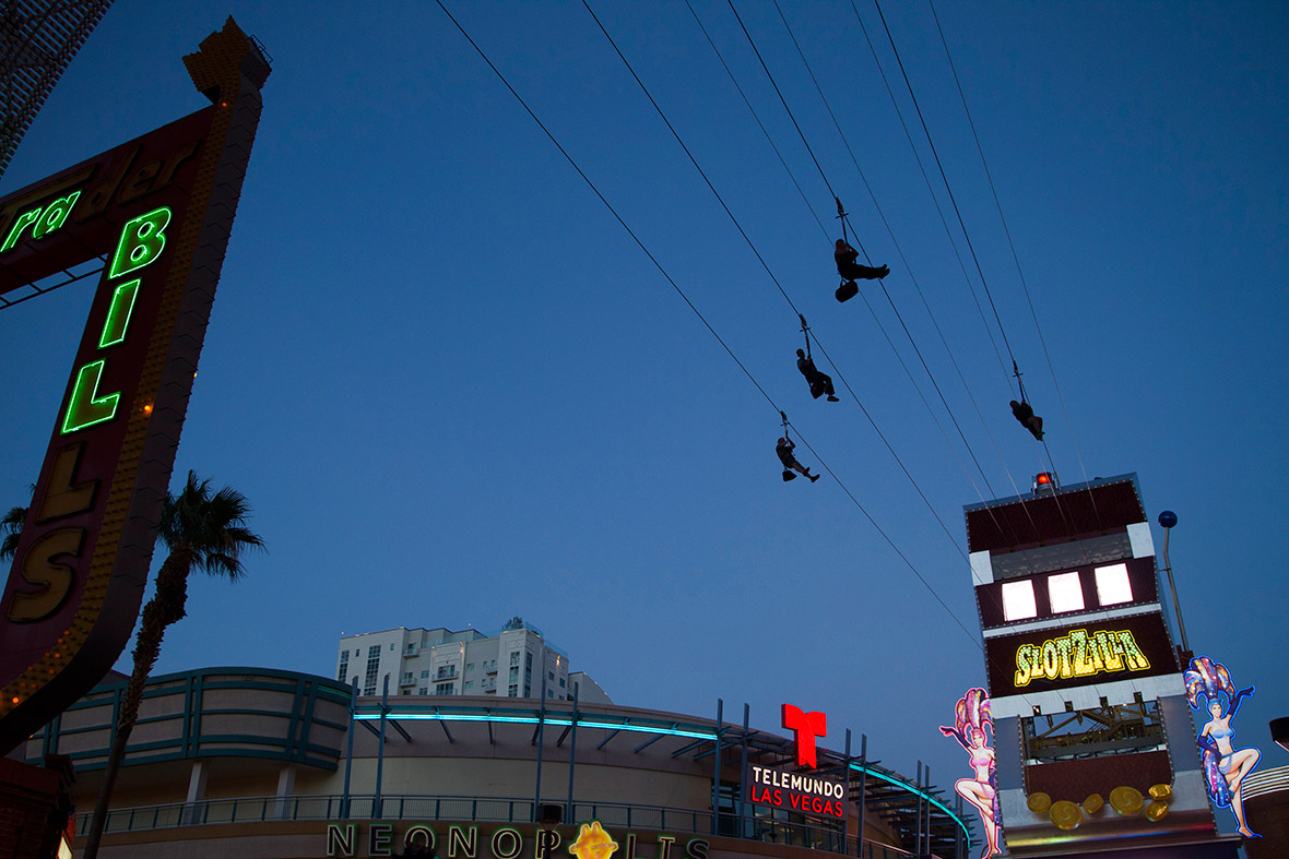 Kia Las Vegas >> Hot Shots Photos of the Day: May Day, Upside Down House ...
