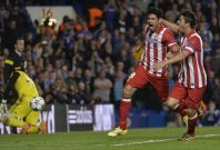 Atletico Madrid\'s Diego Costa celebrates with Koke (R) after scoring a penalty goal against Chelsea during their Champion\'s League semi-final second leg soccer match at Stamford Bridge in London April 30, 2014.