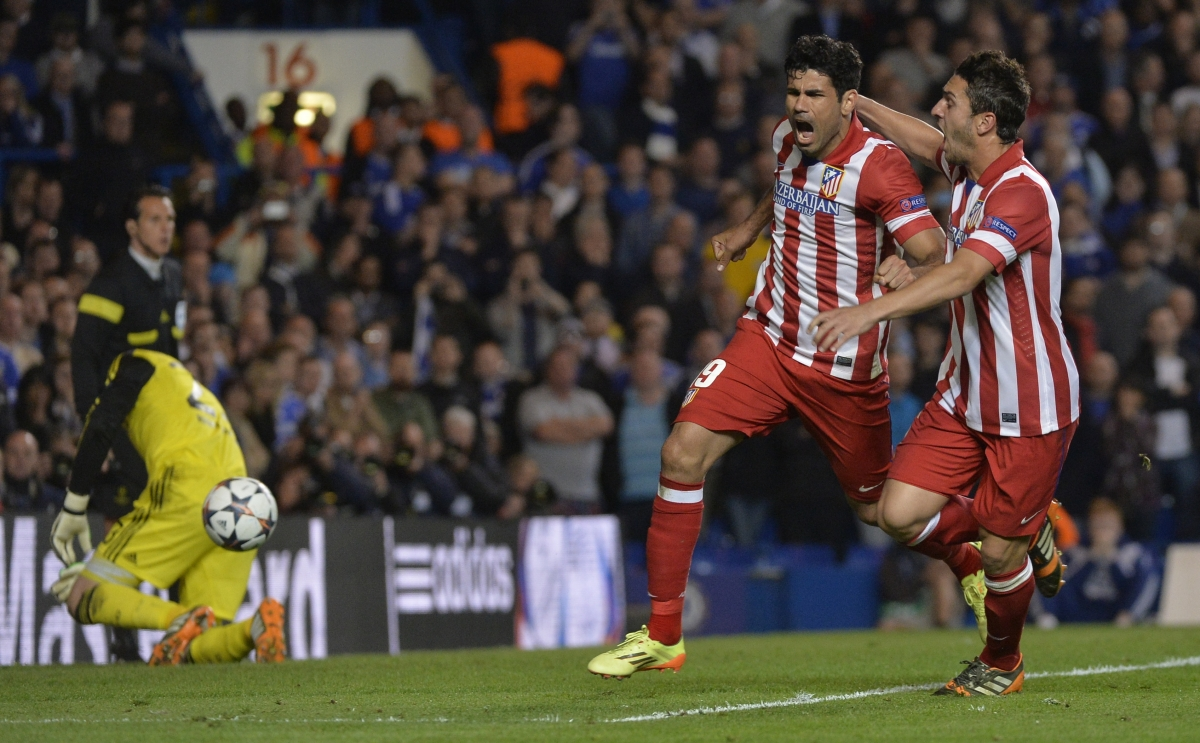 Atletico Madrid's Diego Costa celebrates with Koke (R) after scoring a penalty goal against Chelsea during their Champion's League semi-final second leg soccer match at Stamford Bridge in London April 30, 2014.