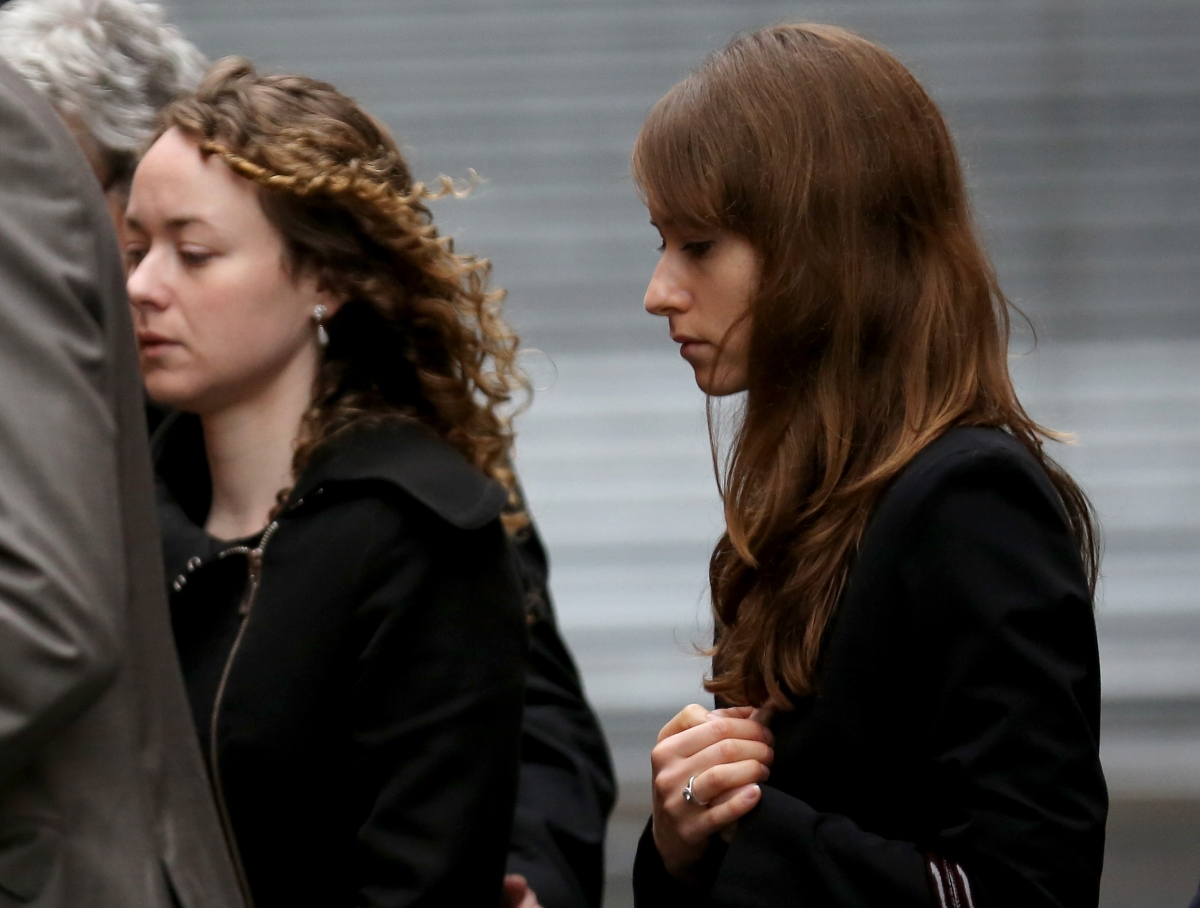 """Kerry (left) and Emma Maguire paid tribute to their """"shining star"""" mother as they attending court to see her accused killer in the dock"""