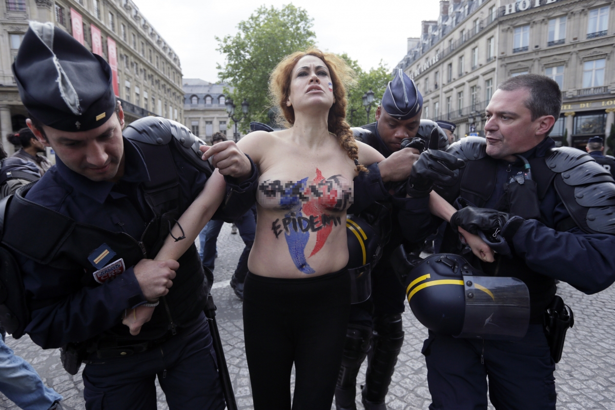 Femen Topless Protesters Storm National Front Joan of Arc May Day Parade France