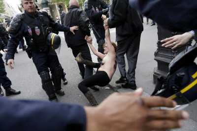 Femen Topless Protest FN Paris National Front May Day parade
