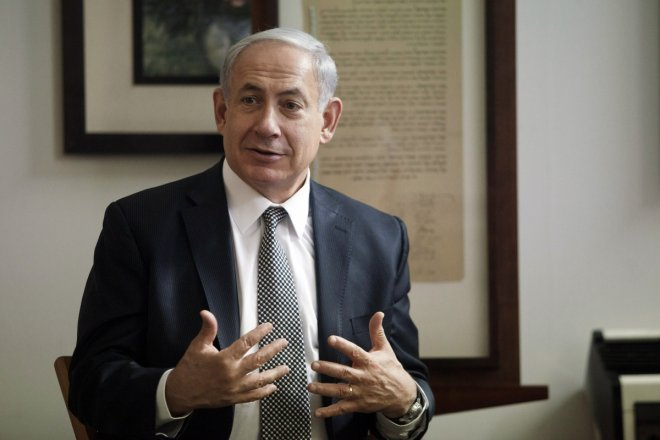 Israeli Prime Minister Benjamin Netanyahu delivers his speech during a news conference in the Independence Hall of Israel in Tel Aviv