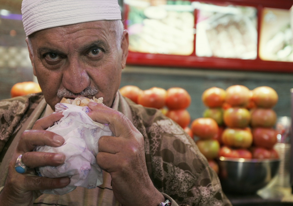 A Lebanese man eats a falafel sandwich at a restaurant in Beirut