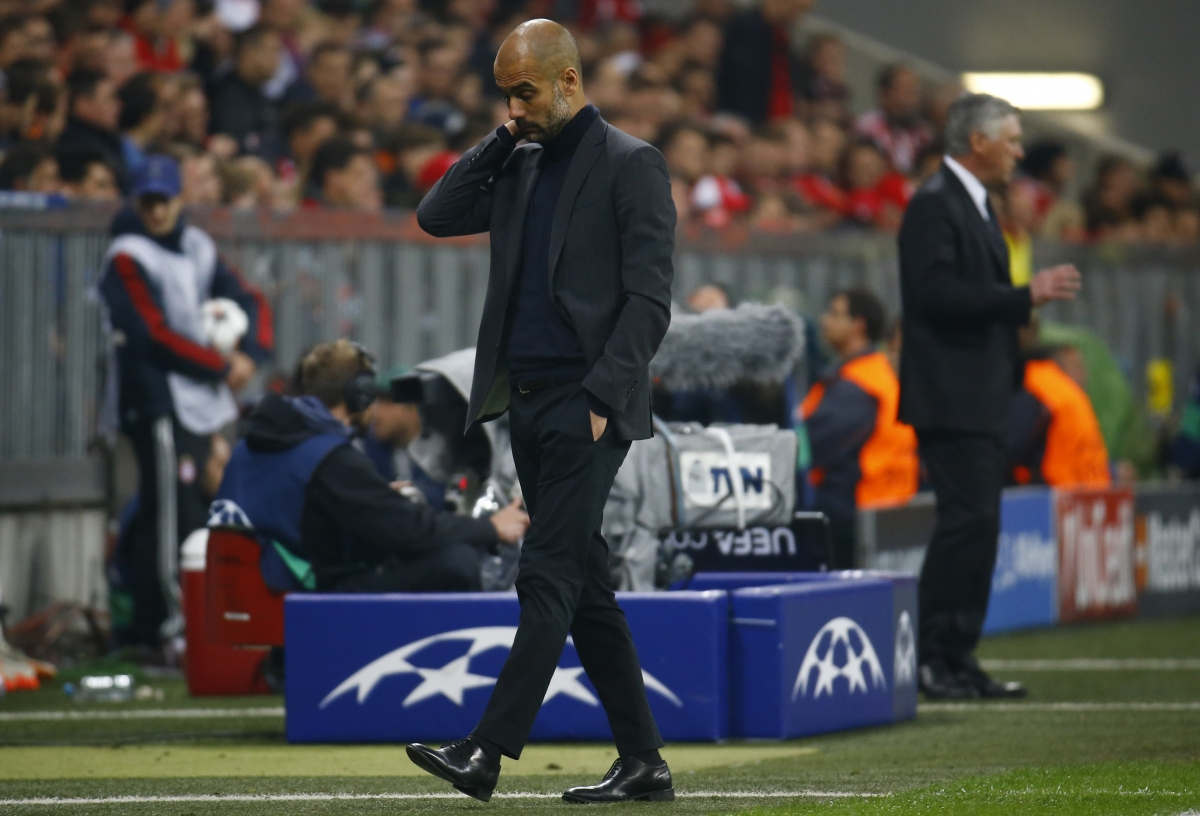 Bayern Munich's coach Josep Guardiola reacts during their Champion's League semi-final second leg soccer match against Real Madrid in Munich April 29, 2014.