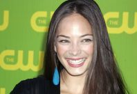 Canadian actress Kristin Kreuk poses as she arrives at the launch party for the CW television network in Burbank.