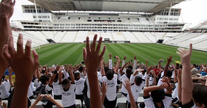 Fans at Arena de Sao Paulo Stadium, one of the venues for the 2014 World Cup in Sao Paulo, Brazil
