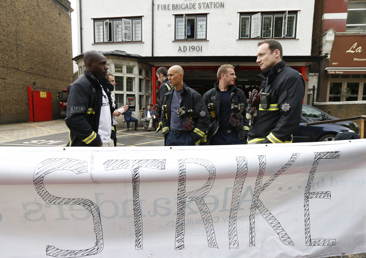 Firefighters on strike outside their northeast London fire station in September, 2013.
