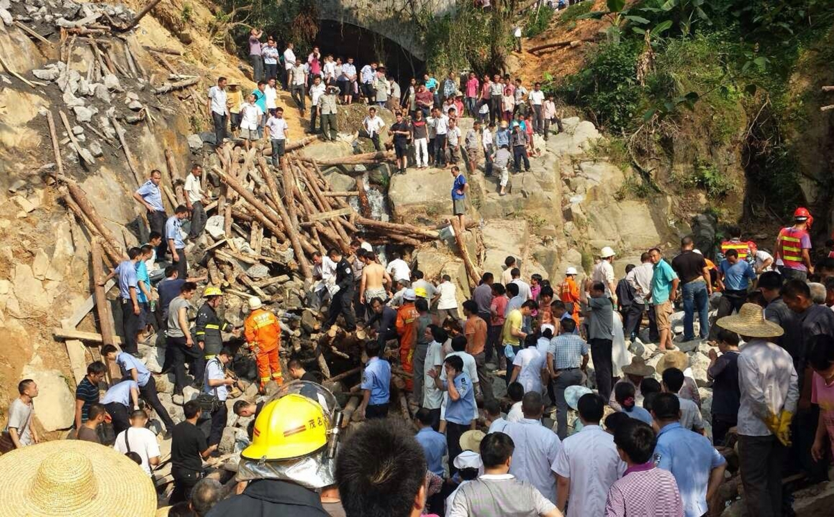 Rescue workers at the scene of the fatal bridge collapse in China