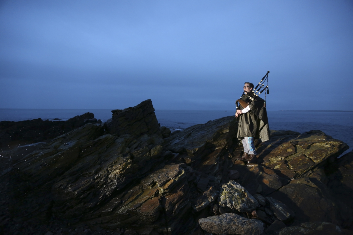 """Piper Danny Hutcheson, 16, poses for a photograph on the coastline of Fraserburgh in Aberdeenshire, Scotland March 6, 2014. Danny will vote """"No"""" in the referendum because he is unsure what would happen with a """"Yes"""" vote."""