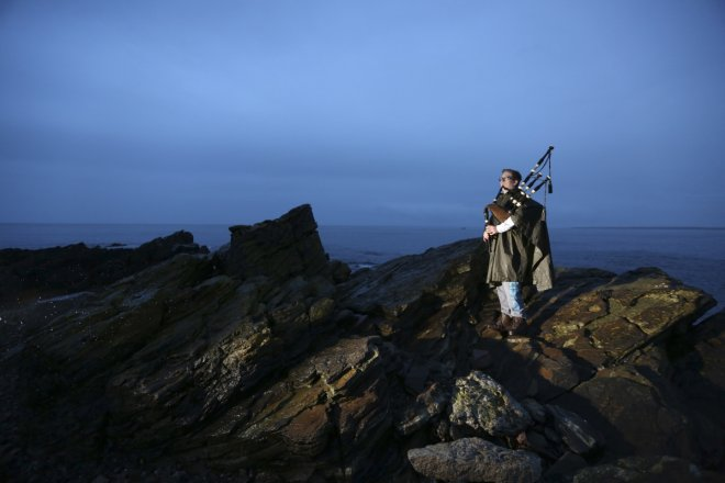 Piper Danny Hutcheson, 16, poses for a photograph on the coastline of Fraserburgh in Aberdeenshire, Scotland March 6, 2014. Danny will vote