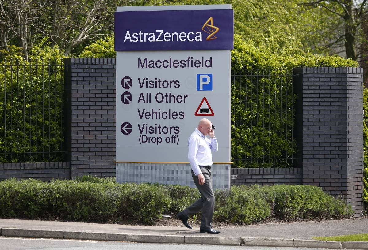 A man walks past an AstraZeneca site in Macclesfield, north England April 28, 2014