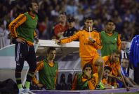 Real Madrid\'s Cristiano Ronaldo (C) and teammates watch their Spanish First Division soccer match against Valladolid from the bench, at Zorrilla Stadium in Valladolid May 7, 2014.