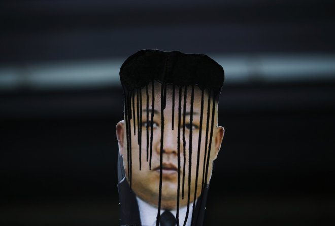 Defeaced placard of North Korea leader Kim Jong Un: The regime has called Barack Obama a