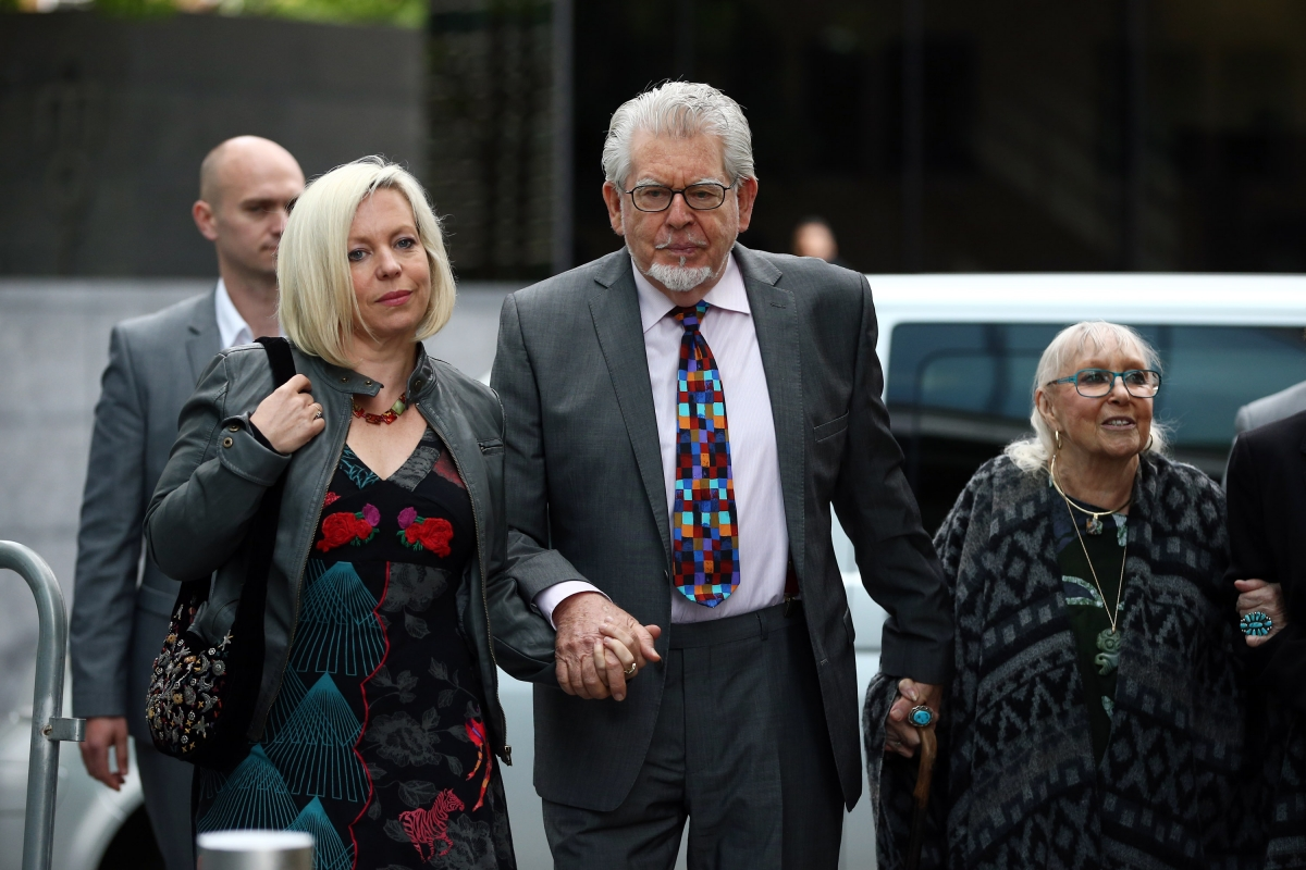 Rolf Harris arrives for his sex crimes trial with his daughter Bindi (l) and wife Alwen Hughes