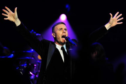 Gary Barlow performs at a fund-raising concert in front of royalty at the Royal Albert Hall in London
