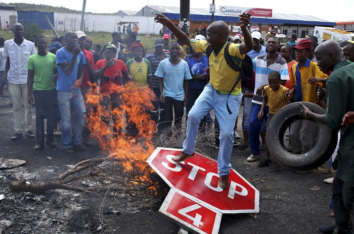 Protesters burned tyres and barricaded roads in Johannesburg's Alexandra township on Friday.